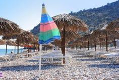 Empty beach with straw umbrellas Royalty Free Stock Photo