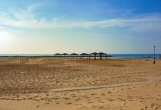 Empty beach with sun canopies and a volleyball net stock photography