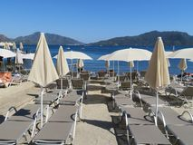 Empty beach with sunbeds on the coast of Turkey Stock Photo