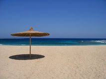 Empty beach with sunshade. In egypt royalty free stock image