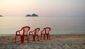 Empty beach three chair Stock Images
