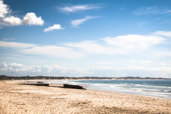 Empty beach in the town Tofo. Very rustic and empty beach at the Indian Ocean in the coastal town Praia do Tofo in Inhambane, Mozambique Royalty Free Stock Images