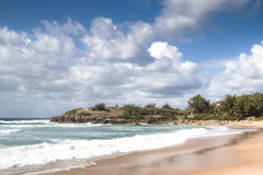 Empty beach in the town Tofo. Very rustic and empty beach at the Indian Ocean in the coastal town Praia do Tofo in Inhambane, Mozambique Stock Photography