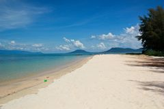 Empty beach on the tropical island of Phu Quoc. Empty beach with clear water and clean sand in the tropical island of Phu Quoc in Vietnam with a nice blue sky Royalty Free Stock Photos