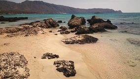 empty beach on the turquoise sea on a sunny day, Crete, Greece Stock Images