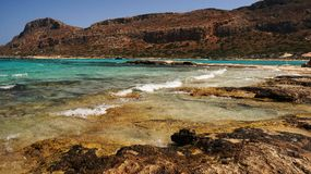 Empty beach on the turquoise sea on a sunny day, Crete, Greece Royalty Free Stock Photo