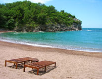 Empty beach with two chairs Stock Photography