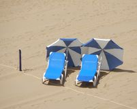 Empty beach. two sunloungers, two parasols Royalty Free Stock Image