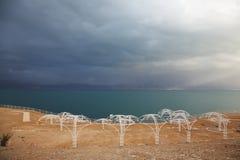 Empty beach umbrellas Royalty Free Stock Photos