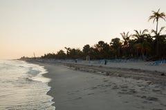 Empty beach in Varadero Cuba. Empty sandy beach with palm trees in the evening in  Varadero Cuba Stock Photo