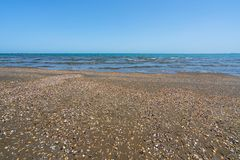 Empty beach of warm blue sea. Landscape royalty free stock images
