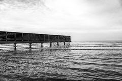 Empty beach, waves and fence Stock Image