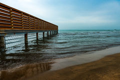Empty beach, waves and fence Royalty Free Stock Photography