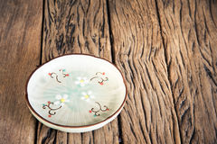 Empty beautiful japanese dish on a wooden table background. royalty free stock images