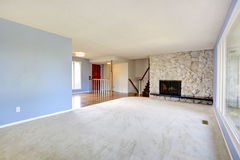 Empty beautiful living room with a fireplace Royalty Free Stock Image