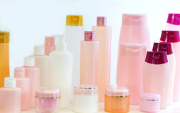 Empty beauty products plastic bottles. Empty blank beauty product or skincare cosmetology plastic bottles or colorful flacons vial on white background stock image