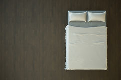 Empty bed. Top view of an empty bed with white bedding. 3D render Stock Images