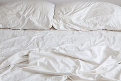 Empty Bed. With disheveled pillows and sheets Stock Image