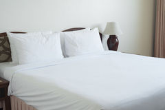 Empty bed in bedroom. Royalty Free Stock Images