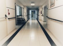 Empty bed in the hospital. Corridor royalty free stock photos