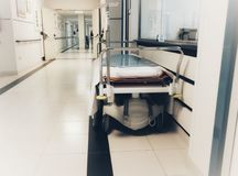 Empty bed in the hospital. Corridor royalty free stock image