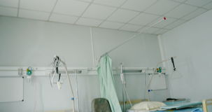 Empty bed in modern hospital. Tilt-down to two empty beds on hospital ward in modern clinic stock footage