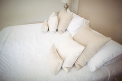 Empty bed and pillow in bedroom. At home Stock Photography