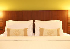 Empty bed with pillows and sheets Stock Images