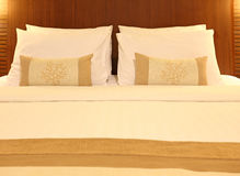 Empty bed with pillows and sheets Royalty Free Stock Images