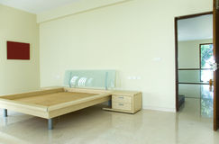 Empty bedroom. An empty bedroom with a new bed Royalty Free Stock Photography