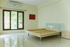 Empty bedroom. An empty bedroom with a new bed Royalty Free Stock Photos