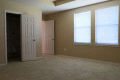An empty bedroom with carpet flooring Stock Image