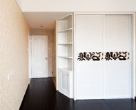 Empty bedroom with doorway and cabinet royalty free stock photos