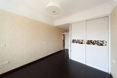 Empty bedroom with droplamp and cabinet Royalty Free Stock Image
