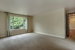 Empty bedroom with carpet floor. stock photo