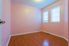 Empty Bedroom in pink color. Empty  Bedroom after renovation in a New House Stock Image