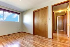Empty bedroom with shiny hardwood floor. Stock Image