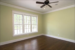 Empty bedroom with windows