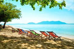 Empty beds are in a row on the beach. Tanning place on the sea.  Stock Images
