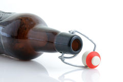 Empty beer bottle. On its side Stock Image