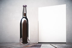 Empty beer bottle and banner Stock Photo