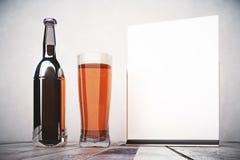 Empty beer bottle and billboard Stock Photo
