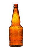 Empty beer bottle with water drops Royalty Free Stock Photos