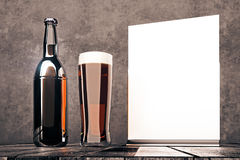 Empty beer bottle and whiteboard Stock Images
