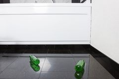 Empty beer bottles on black granite floor Royalty Free Stock Photos