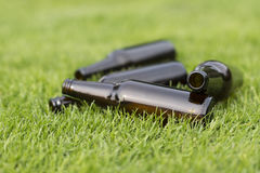Empty beer bottles in the grass. Empty beer bottles in a grass field with a vague background Stock Photos