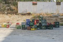Empty beer containers. Old and empty beer containers on the street in Sfakaki village , Crete , Greece. Europe Royalty Free Stock Photos