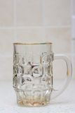 Empty beer glass. On kitchen ground Stock Photography