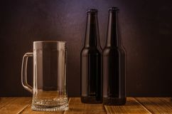 Free Empty Beer Glass And Two Bottles/ Empty Beer Glass And Two Bottles On A Bar Royalty Free Stock Photo - 136862545