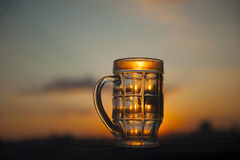 Empty beer glass on sunset royalty free stock photo